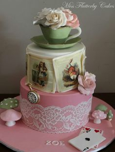 Alice in Wonderland cake.  Love the hand painted pictures