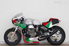 There's a very interesting idea behind this brutal-looking Moto Guzzi Le Mans custom, described by builder Davide Caforio as having a 'false history.' It's a tribute to the endurance racers of the 1980s—a bike that the Italian factory might have built if it was competing against the Cooley and Crosby Suzukis, or Wayne Gardner's Honda. It's one of our Top 5 Moto Guzzi Le Mans picks—see the others at http://www.bikeexif.com/top-5-moto-guzzi-le-mans