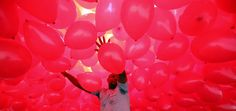 A man in São Paulo on Tuesday prepares balloons to be released into the sky as part of year-end celebrations. Snow Cones, Dec 30, Wall Street Journal, Balloons, Sky, Tuesday, Celebrations, Heaven, Globes