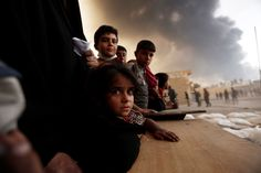 President Trump put a four-month hold on allowing refugees into the United States and temporarily barred visitors from Syria, Iran, Iraq, Libya, Somalia, Sudan and Yemen. The Syrian refugee program, suspended until further notice, will eventually give priority to minority religious groups fleeing persecution. Trump said in an interview the exception would help Syrian Christians fleeing the civil war there. (Reuters) See more news-related photo galleries and follow us on Yahoo News Photo…