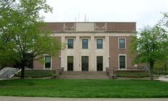 Denison University Library - Granville, Ohio - The 7th tier of the Denison University Library is said to have a spirit, a shadowy woman wearing an old-fashioned dress. Those who fall asleep here, especially men, have been awoken by her hitting them on the back of the head.