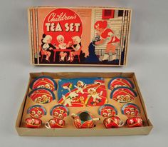 Ohio Art tin children's toy teaset (teapot, serving tray, plates, cups and saucer for 4) ... decorated with little girls dressed as cats, in box w/ scene of girls' tea party on the lid, early-mid 20th century, tin litho, USA