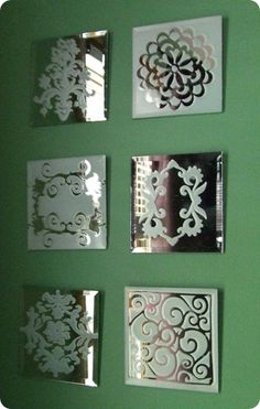 DIY Mirrors: Cut designs on contact paper, spray with frosted glass paint, remove decal.