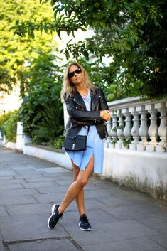 Lucy Williams wears classic blue shirt dress with a leather jacket and trainers. Leather jacket: Belstaff, Shirt Dress: Gant Rugger, Trainers, Nike Air Max.
