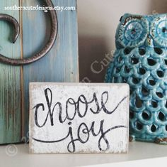 This cute little wood block sign is the perfect reminder to choose joy! This hand painted wood block is the perfect addition to any mantle, windowsill, desk, shelf or side table. ......DETAILS...... • approx. 6X4 freestanding block • white distressed background with hand painted lettering • hardware can be attached to hang on a gallery wall, message me for details! Each item is freehand painted by me. My signs are never stenciled! I hand letter and paint each and every sign! You are gett...