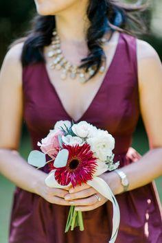 Marsala bridesmaid bouquet, photo by Caroline Lima Photography http://ruffledblog.com/backyard-atlanta-wedding-with-burgundy-accents #weddingbouquet