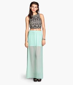 Maxi skirt in airy chiffon with high slits at sides. Elasticized waistband and short, attached liner skirt.