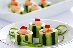Peeled cucumbers are cut and filled with protein rich hummus and garnished with roasted red peppers to make these beautiful Hummus Filled Cucumber cups.