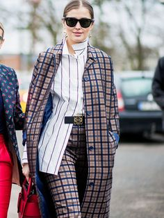 Glance over street style looks from the recent Copenhagen Fashion Week and you'll notice one key trend: checked coats.