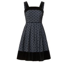 Orla Kiely: Wool blend fabric strappy dress with Polka Daisy flock. Dress has contrast solid black velvet straps, bodice band and hem band. Velvet piping at waist seam. Zip and button at center back to fasten.    Length: 28in (without straps)
