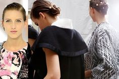 Chanel sleek low bun hairstyle with pearl accents | allure.com