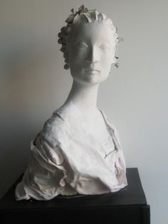 Nancy Wiley--Paper Mache and Paperclay. Amazing how smooth and flawless her skin appears.