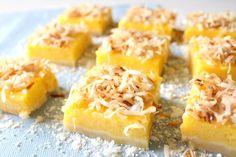 Mango Lemon Bars with Toasted Coconut Similar to a lemon bar, with a tropical flair. They feature a shortbread crust, smooth mango lemon filling, and a topping of slightly sweet toasted coconut. Mango Desserts, Köstliche Desserts, Delicious Desserts, Yummy Food, Lemon Recipes, Baking Recipes, Sweet Recipes, Juice Recipes, Recipes With Mango