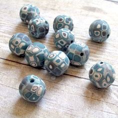 Learn how to make your own polymer clay beads by applying colorful cane slices