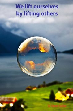 We went out early one morning and tried to make giant soap bubbles. The sun was rising above the mountain behind us and I managed to capture the sunrise in the reflection of a bubble floating out the fjord. Captured in Viddal, Norway.