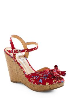 bows and flower on shoes - a trend that's everywhere for spring 2012.  these flower of love wedge shoes are from modcloth.
