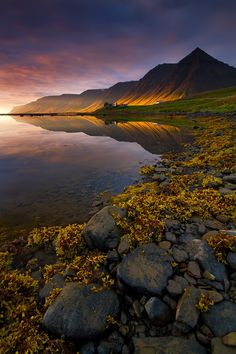 Korpudalur Iceland  We spent a few days travelling around the beautiful West Fjord region of northwest Iceland in 2010. This was one of the most memorable scenes of our trip as the sun sent it's near horizontal rays across the base of the mountains.