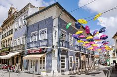 """Águeda: Umbrella Sky Project 2014 -""""add colour to your life!"""" — is an annual art installation - the floating umbrellas, as part of AgitÁgueda, a July festival promoting local culture and the arts in Aveiro #Portugal"""