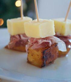 Cheddar, Ham & Carmelised Pineapple - 10 cocktail sticks, 10 cubes pineapple, 1 T soft dark brown sugar, 1 T unsalted butter, ham, good Cheddar, cut into 10 cubes: Toss pineapple cubes in sugar. Melt butter & fry pineapple-1 minute, until sugar is caramelised & pineapple is golden. Thread pineapple thru sticks, followed by ham then cheese.