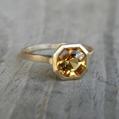 Asscher Cut Citrine set in 14k yellow Gold, Asscher Gemstone Ring, Solitaire Design Made To Order. $1,048.00, via Etsy.