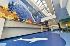 Photo Tour: Shriners Hospitals for Children—Canada | Healthcare Design --- The child life services playroom and classroom on the 4th floor has an under-the-sea theme, with a large mural of whales, fish, and other sea creatures. The lights resemble bubbles slowly floating to the surface. Photo: Benoit Desjardins