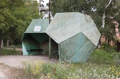 The photographer remarked: 'These extraordinary bus stops show the range of public art fro...