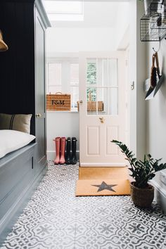 Pink Ground Painted Back Door - Utility And Boot Room With Down Pipe Painted Custom Tiles And Patterned Tile Floor. Porch Interior, Interior Design, Boot Room Utility, Utility Cupboard, Tiled Hallway, Entryway Tile Floor, Entry Tile, Painting Tile Floors, Paint Floor Tiles
