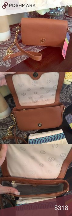 SALE Authentic NWT Tory Burch Chain Mini Crossbody Chestnut colored. Comes with dust bag! Bought for myself but I have too many bags and need to downsize! NO trades ‼️ please don't ask. Same/next day shipping on this item. I am open to offers ! Just use the offer button below 🎉⬇️⬇️⬇️❤️.                              Dimensions: 8L x 2W x 5H STRAP DROP : 21 inches Tory Burch Bags Crossbody Bags