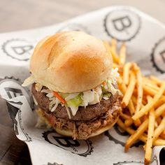 Burger Love: Michael Symon's incredible burger is topped with pulled pork, coleslaw, barbecue sauce and bacon. / © Paul Sobata