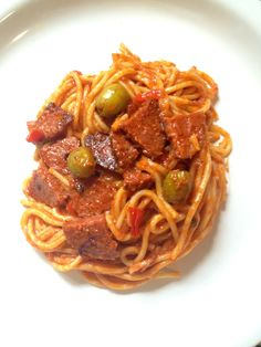 Dominican Spaghetti -- I had to go back and make more sauce, if  you are making a whole box of spaghetti, you will need more sauce than is listed. I threw on some sriracha on my own plate for a little kick. Everyone loved it! Will become a regular dish in my house :)