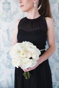 All white bouquet and black bridesmaid dress: http://www.stylemepretty.com/new-york-weddings/new-york-city/brooklyn/2015/12/03/modern-brooklyn-winery-winter-wedding/ | Photography: Ashley Caroline - http://www.ashley-caroline.com/