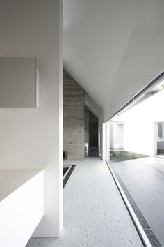 The Lik House by Satoru Hirota Architects. Beautiful contrast between the grey, raw concrete and the smoot abtract white.