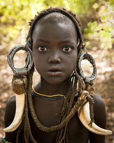 Mursi tribe girl; Omo; Ethiopia.
