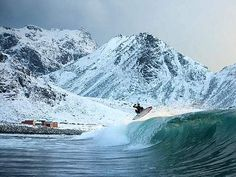 Holy shit! Now that's some cold water surfing!
