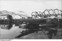 German Do 24 aircraft at Narvik, Norway, Apr 1940; note damaged buildings in background