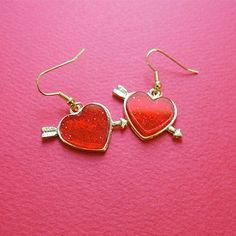 #mixxmix Heart And Arrow Hook Earrings (BXFM) Enjoy the pretty glittered red heart of these earrings! #mxm #hideandseek #has #365basic #bauhaus #99bunny#koreanfashionstyle #girlsfashion #lovelywoman #kstyle #koreangirls #streetfashion #twinlook #dailyoutfit #styling