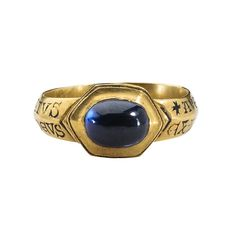 Devotional Ring Date: 13th century Culture: British (?) Medium: Gold and sapphire Dimensions: Height 26.6 mm.; hoop inner diam. 20 mm.; hoop outer diam. 23.5 mm; bezel 10 x 13.4 mm.; weight 8.71 g. Classification: Metalwork-Gold