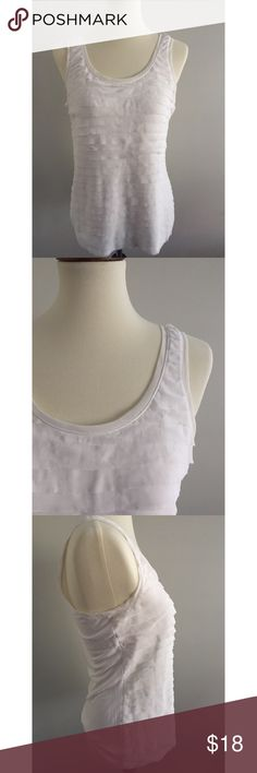 """White House Black Market Spandex Ruffle Tank In excellent condition with no rips, stains, pilling, etc. Great staple piece and goes with everything. Extremely lightweight and comfortable and perfect for the warmer months.  Size Medium Made in Vietnam  95% Rayon, 5% Spandex  Shoulder to hem: 24"""" Pit to pit: 18"""" Machine Wash Cold White House Black Market Tops Tank Tops"""