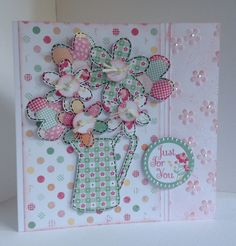 Card designed by Julie Hickey using Country Charm 6x6 paper pad, die cuts and template. Pretty card with jug of flowers made using template and on a floral embossed edge card blank.