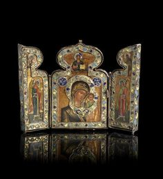 A gilt-metal and enamel travelling triptych iconRussian, 18th century