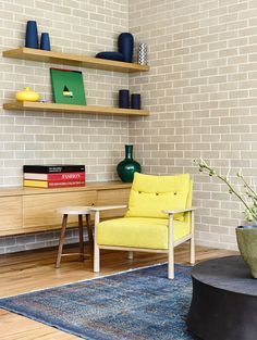 Floating shelves and pops of color bring together the exposed brick