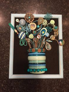 This is a 100 percent handmade recycled jewelry art 3D flower bouquet. First I glue black felt on cardboard backing and then I securely glue the jewelry on the fabric. The jewelry ranges from contemporary to vintage. I use beads, rhinestones, charms, and pendants, from necklaces,