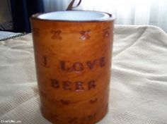 http://www.craftme.co/Hand-Tooled-Leather-Stubby-Coolers-with-Foam-Insert,name,116232,auction_id,auction_details