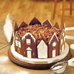 Christmas cake flanked by snowy chocolate houses