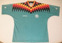 This vintage 1994 embroidered Adidas German soccer jersey from the Deutscher Fussball Bund is in excellent used condition. Teal green with black orange and gold accents and white embroidering.