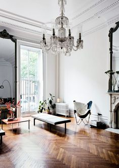 Parisian apartment, home decor, high ceilings, chandelier, chevron hardwood floor