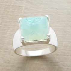 CHISELED CHALCEDONY RING--A bounteous blossom is hand carved into our chunk of gemstone in this sea green chalcedony