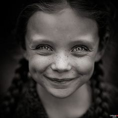She has a beautiful smile but old eyes