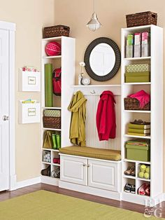 Mud may connote a mess, but a well-designed mudroom is anything but. One unused wall adjacent to the door to the garage became a fun (and functional) mudroom with the addition of bookcases, a wall cabinet, and a new pendant. Two bookcases ($34.99) anchor this makeover. The baseboard wrapping the base creates a custom-built look. For extra storage, divide the bottom units to create cubbies for shoes.