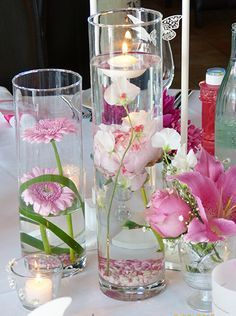 Cylinder vase with floating flowers, submerged. Floating candles with gerbera and peonies in the color pink, pink and white in the vineyard Flick, Falkenberg Flörsheim Wicker, Hofheim. Floating Flowers, Floating Candles, Flower Decorations, Wedding Decorations, Table Decorations, Cherry Blossom Wedding, Wedding Dress Cake, Candle Centerpieces, Centre Pieces